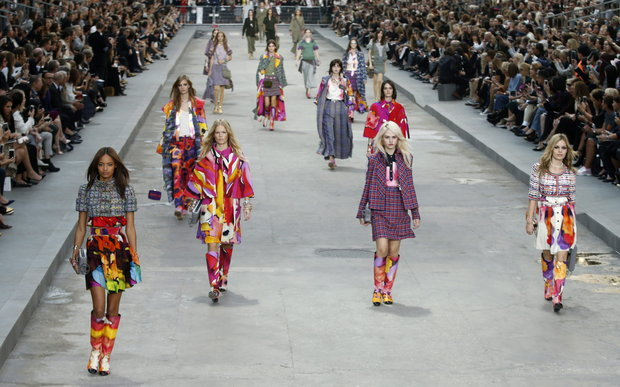 epa04424228 British model Georgia May Jagger (R) and other models present creations from the Spring/Summer 2015 Ready to Wear Collection by German designer Karl Lagerfeld for Chanel during the Paris Fashion Week, in Paris, France, 30 September 2014. The presentation of the Women's collections runs from 23 September to 01 October. EPA/CHRISTOPHE KARABA