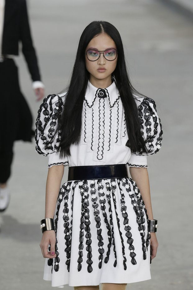 A model presents a creation by German designer Karl Lagerfeld as part of his Spring/Summer 2015 women's ready-to-wear collection for French fashion house Chanel during Paris Fashion Week September 30, 2014. Karl Lagerfeld created an immense Boulevard Chanel for his fashion show on Tuesday, even staging a street demonstration by fashionably dressed models for Spring/Summer 2015. REUTERS/Gonzalo Fuentes (FRANCE - Tags: FASHION)